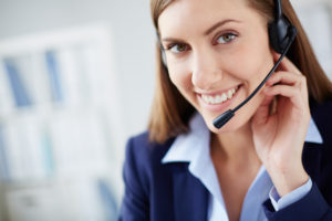 Woman with headset responding to a contact
